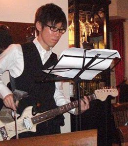 Violafon and it`s inventor Yoshifumi Hori playing it.