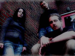 My Pet Junkie 2005. ( L to R) Julia Bell - Bass, Keys, Vocals. Leon Camfield - Drums, Electronic Percussives, Vocals. Myself - Guitar, Vocals)Photo by Ben Gom