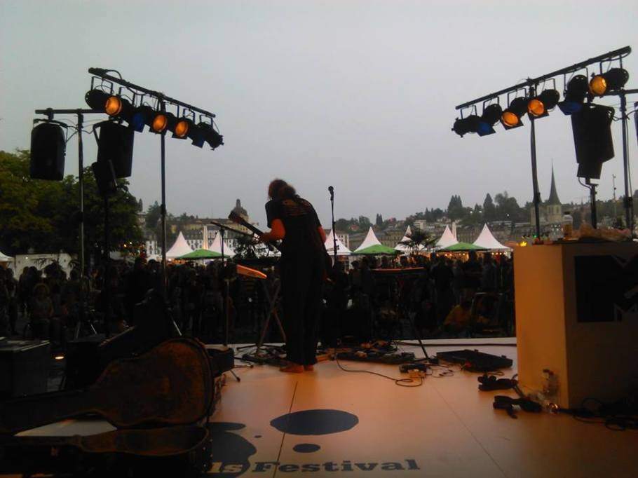 Performing to the crowd at Blue Balls festival overlooking the lake. The Storm was still looming but never did it return to such ferocity.